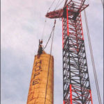 Crane Removing Top of Smokestack