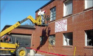 Removal of asbestos-containing window systems, exterior view